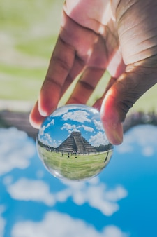 A picture of the chichen itza inside of the crystal ball