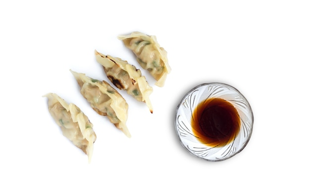 Picture of  dumplings or gyoza with soy sauce isolated on white