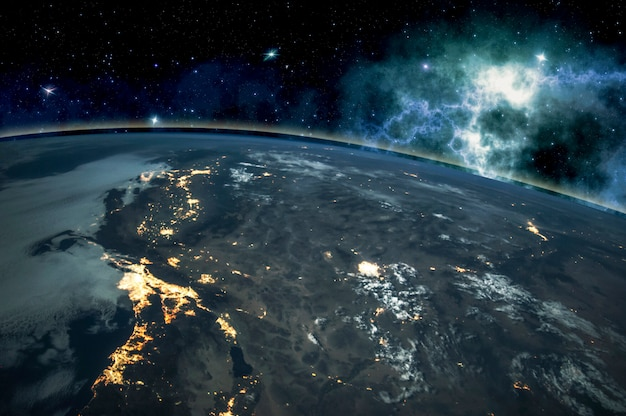 Picture of earth in space, stars all around, night sky. elements of this image furnished