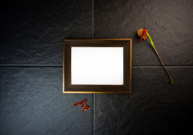 Picture frame on black stone wall