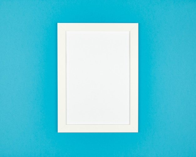 Picture frame flat lay on textured pastel blue paper background