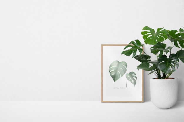 Picture frame leaning against a white wall