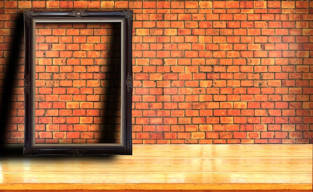 Picture frame on red brick wall