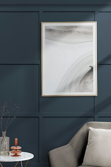 Picture frame with abstract art by a gray velvet armchair