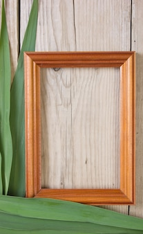 Picture frame on a wooden background