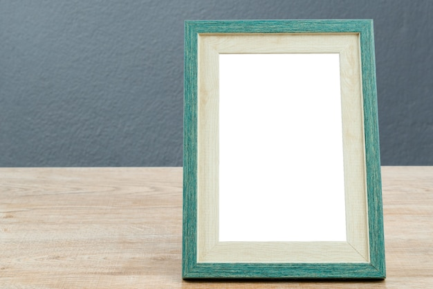 Picture frame wooden on table with gray wall  concrete texture background.