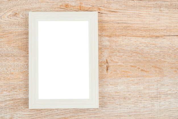 Picture frame on wooden wall texture background.
