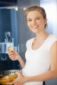 Picture of happy and smiling teenage girl with chips