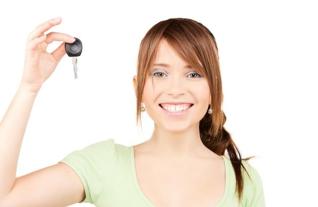Picture of happy teenage girl with car key