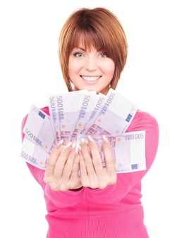 Picture of happy woman with money over white