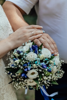 Picture of man and woman with bridal bouquet young married couple holding hands