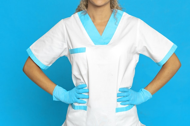 Picture of a nurse against a blue wall
