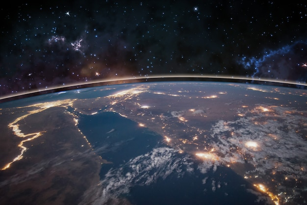 Картина земля в космосе, звезды вокруг, ночное небо. элементы этого изображения предоставлены