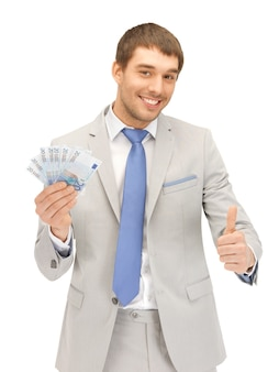 ユーロの現金でハンサムな男の写真