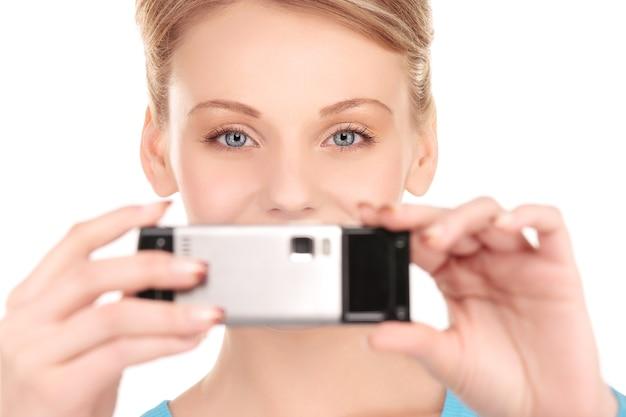 전화 카메라를 사용 하여 행복 한 여자의 그림