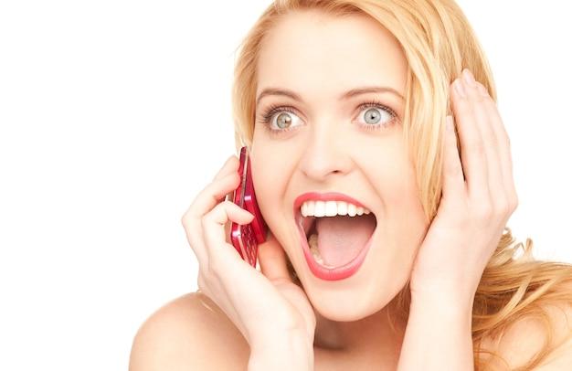 Изображение счастливой женщины с мобильным телефоном Premium Фотографии