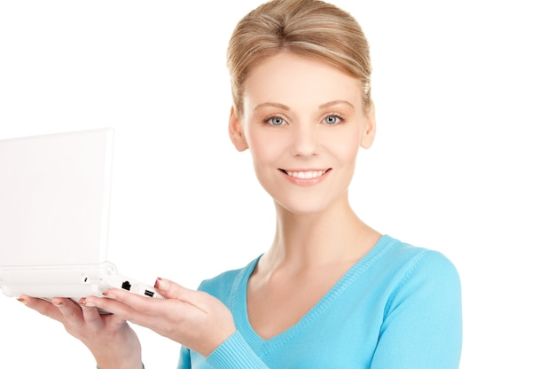 노트북 컴퓨터와 함께 행복 한 여자의 그림