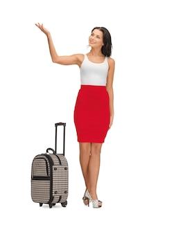 スーツケースの挨拶と幸せな女性の写真