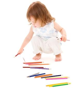 흰색 위에 컬러 연필과 어린 소녀의 그림