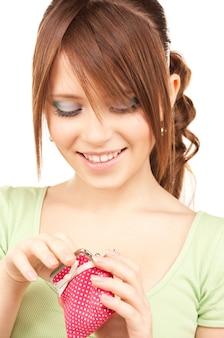 지갑과 사랑스러운 십 대 소녀의 그림