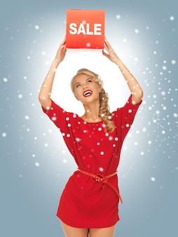 Картина прекрасной женщины в красном платье со знаком продажи