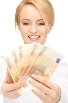 ユーロの現金で素敵な女性の写真