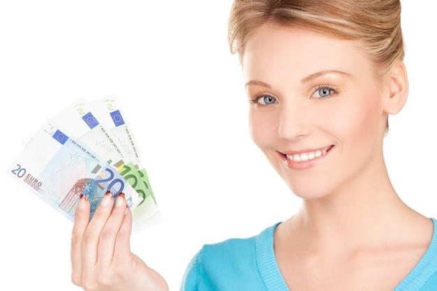 Картина прекрасной женщины с деньгами в руках