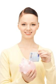 貯金箱を持つ素敵な女性の写真