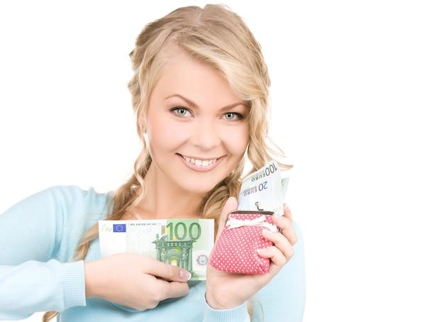 지갑과 돈을 가진 사랑스러운 여자의 그림