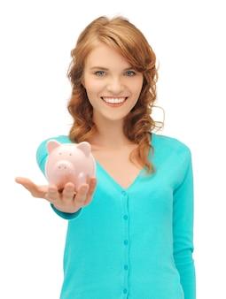 Изображение девочки-подростка с копилкой