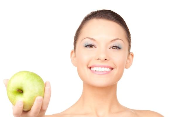 青リンゴと若い美しい女性の写真