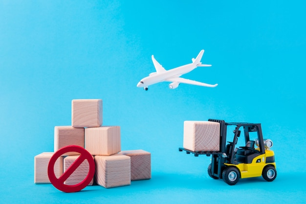 Picture of plane flying electric forklift carry pile stack cube forbidden sign