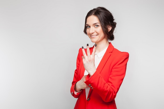 Picture of pretty woman in red blazer showing signs