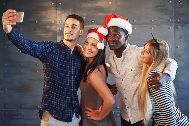 Picture showing group of multiethnic friends celebrating new year