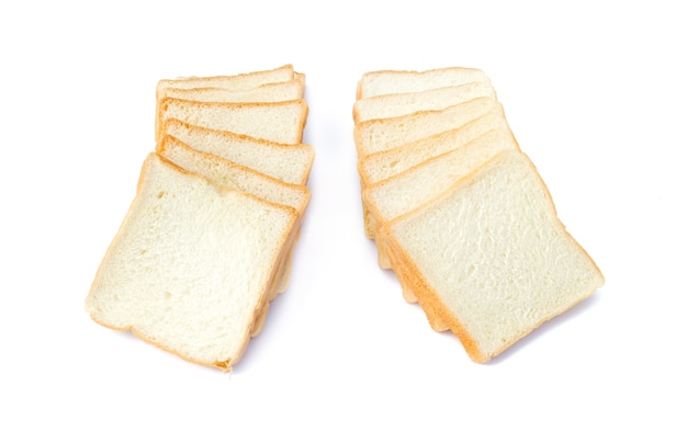 Picture of sliced soft and sticky delicious white bread for breakfast on white isolated background
