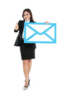 Picture of smiling businesswoman holding sign of envelope