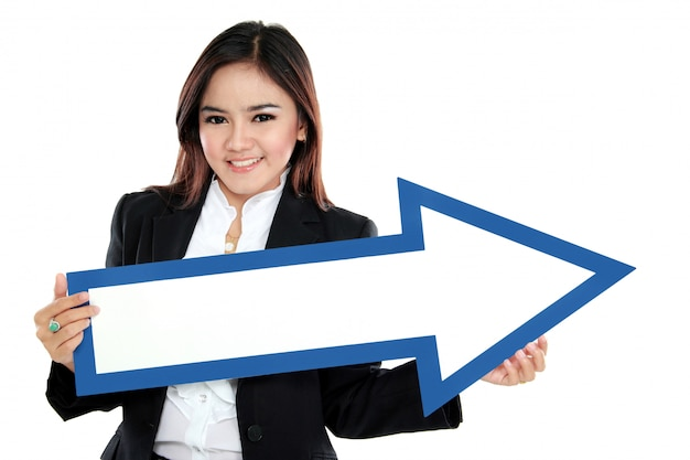 Picture of smiling businesswoman with direction arrow sign