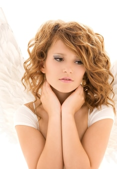 Picture of unhappy teenage angel girl over white