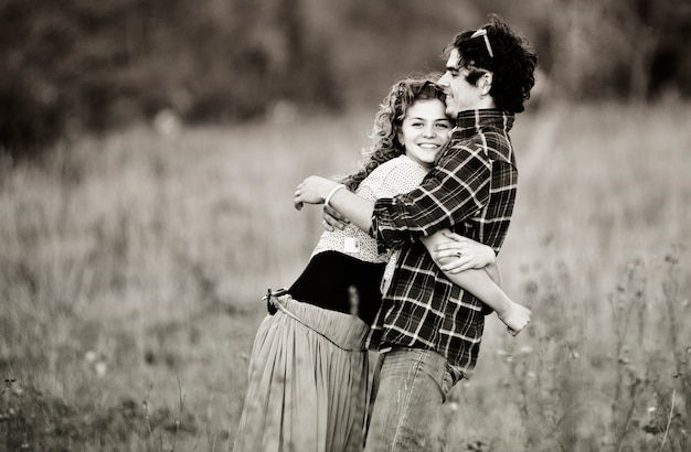 Picture of vintage way dressed yang pretty couple outdoor.