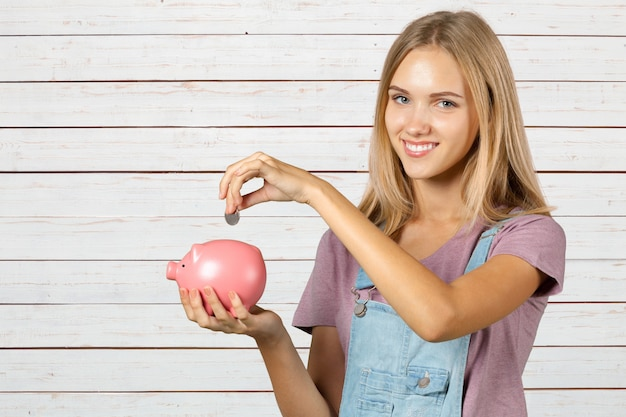 Picture of woman with piggy bank