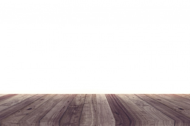 A picture of a wooden desk in front of an abstract background of white.