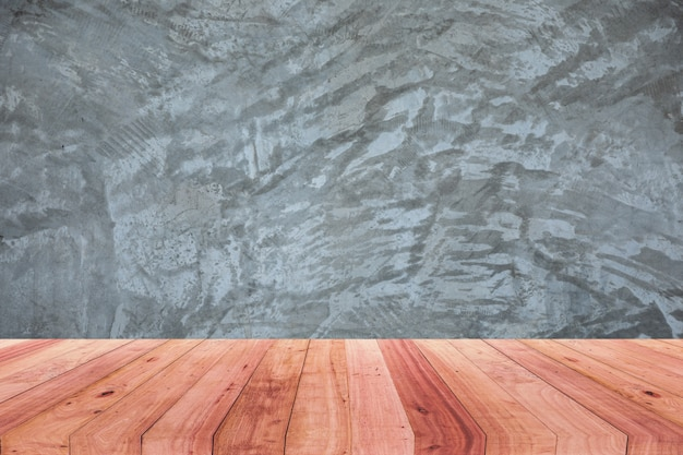 A picture of a wooden desk in front of an abstract blurred background of a polished cement