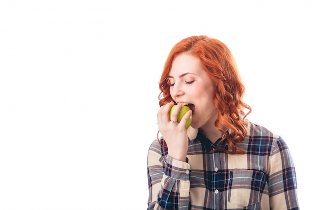 Picture of young woman eating apple