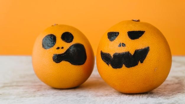 Pictured oranges with scream and smirk faces