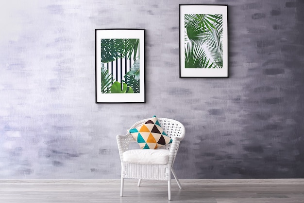 Pictures with tropical leaves in modern room interior