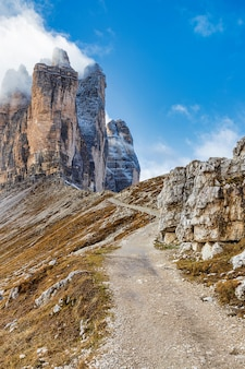 Picturesque hiking trail in dolomite alps with a view of famous tre cime mountains