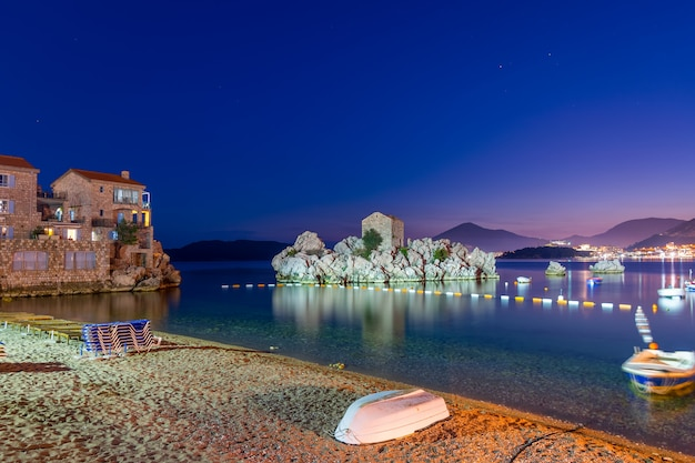A picturesque island near a cozy village on the shore of the adriatic sea.