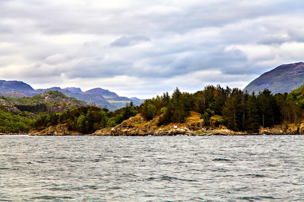 The picturesque landscape: rocks, trees and sea