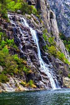 Picturesque landscape with waterfall and rocks