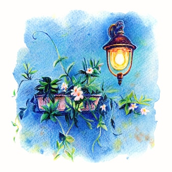 Picturesque lantern and flowers on blue wall of house on the famous island burano, venice, italy